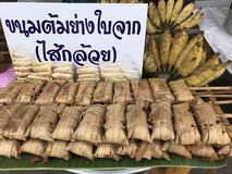 Local dessert from southern Thailand made of grilled sticky rice stuffed with banana Stock Photo