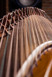 Local details of  Guzheng. The guzheng or gu zheng (Chinese: 古箏), also simply called zheng (箏, gu 古 means ancient), is a Chinese plucked zither. It has Royalty Free Stock Photos