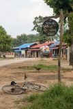 Local dirt road with colorful houses near inle lake in myanmar stock image