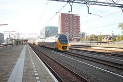 Local double decker intercity train on the railway station of Leiden in the Netherlands. Local double decker intercity train on the railway station of Leiden in stock photography