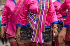 Local dress of female in Thai wax festival. stock photos