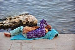 An elder relaxes in Varanasi, India. An local elder relaxes in Varanasi, India stock image