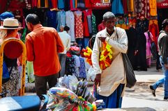 A local elder sells goods in Varanasi, India. A local elder sells goods to tourists in Varanasi, India royalty free stock images