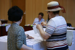 LOCAL ELECTIONS IN ROMANIA 2016. A person votes at a pooling center, during local elections, in Bucharest, Romania, Sunday, May 05, 2016 Royalty Free Stock Photo