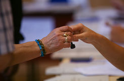 LOCAL ELECTIONS IN ROMANIA 2016. A woman hand stamp at a pooling center, during local elections, in Bucharest, Romania, Sunday, May 05, 2016 Stock Image