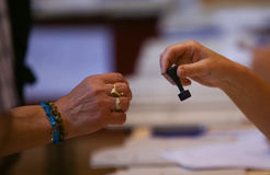 LOCAL ELECTIONS IN ROMANIA 2016. A woman hand stamp at a pooling center, during local elections, in Bucharest, Romania, Sunday, May 05, 2016 Royalty Free Stock Photography