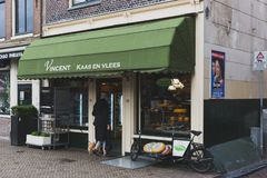 Local entering a cheese shop in downtown Amsterdam royalty free stock photography