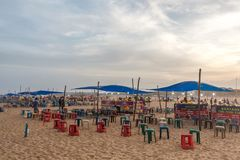 Local enterpreneurs selling eatables at marina beach and arranged seats for their customers. And beautiful dark clouds seen during sunset,Chennai,India 19 aug stock image
