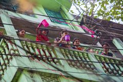 Local families celebrate Holi Festival, also known as `The Festival of Colours` in Shakhari bazar, Dhaka, Bangladesh. Shankhari Bazar is located near the Stock Images