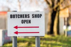 Local Family Business Butchers Shop Open directional sign post.  Stock Images