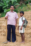 Local farmer and his son stand on tea plantation Royalty Free Stock Image