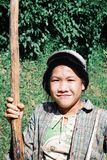 local farmer woman on the way back from the fields with a large stick to help her walk royalty free stock photos