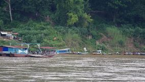 Local ferry boat carry people across Mekong river. Luang prabang, Laos - AUGUST 7, 2015: Local ferry boat carry people across Mekong river AUGUST, 2015 in luang stock video