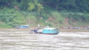Local ferry boat carry people and other vehicles across Mekong river. Luang prabang, Laos - AUGUST 7, 2015: Local ferry boat carry people and other vehicles stock video
