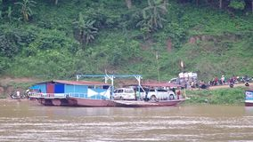 Local ferry boat is going to stop at the bank. Luang prabang, Laos - AUGUST 8, 2015: local ferry boat is going to stop at the bank of Mekong river AUGUST, 2015 stock footage