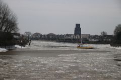 Local ferry between Gouderak and Moordrecht between the ice flak. Es on river Hollandse IJssel in Netherlands Stock Photo