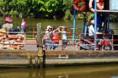 Local ferry on the Mekong Delta. School children on a local ferry travelling along the Mekong Delta, Asia Royalty Free Stock Image