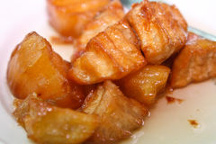 Local Filipino food - Golden Sweet Potato. A landscape image of delicious golden brown sweet potato in sugar glazing.  A traditional Filipino desert Royalty Free Stock Photography