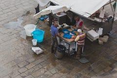 Local fish vendors preparing fish at a Saturday morning market stock image