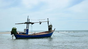 Local fisherman boat moor at the beach when Low tide time cha-am thailand stock footage