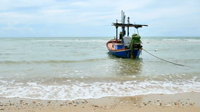 Local fisherman boat moor at the beach when Low tide time cha-am thailand stock video