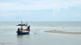 Local fisherman boat moor at the beach when Low tide time cha-am thailand stock video footage