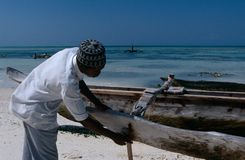 A local fisherman and his boat, Zanzibar Royalty Free Stock Photos