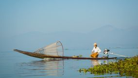 Local fisherman is moving quickly on the boat with a modern engine. Inle Lake, Myanmar stock video