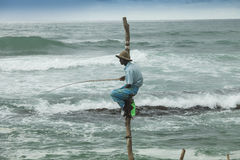 Local fisherman on a pole Royalty Free Stock Photo