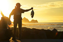 Local fisherman showing off his catch of the day with pride on sea front Royalty Free Stock Photography