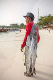 Local fisherman with two big fishes on the beach. Royalty Free Stock Images