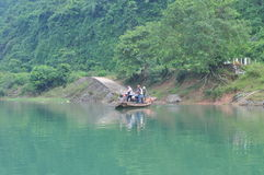 Local fisherman is using his small boat as a ferry to transfer people Royalty Free Stock Image
