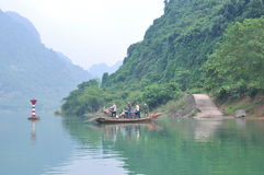 Local fisherman is using his small boat as a ferry to transfer people Stock Image