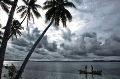 Local fishermen in a boat, Ofu island, Tonga Royalty Free Stock Photo