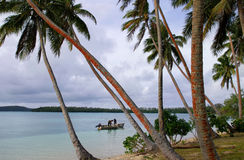 Local fishermen in a boat, Ofu island, Tonga Stock Images