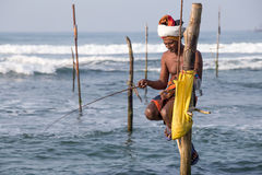 Local fishermen are fishing in unique style in South Sri Lanka Royalty Free Stock Photos