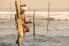 Local fishermen are fishing in unique style. Sr[ Lanka Royalty Free Stock Images