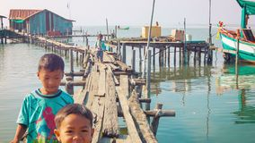 Local fishermen kids running on the walkways near the water stock footage