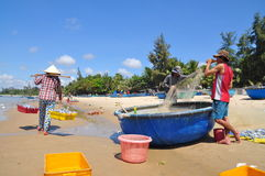 Local fishermen are preparing their fishing nets for a new working day in the Lagi beach Royalty Free Stock Images