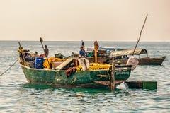 Local fishermen on a traditional boat near Stone Town, Zanzibar Royalty Free Stock Image