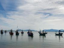 Boats in the sea. Local fishery boats in Pranburi area of Prachuab-Kirikhan province of Thailand come back in the dusk Stock Photos
