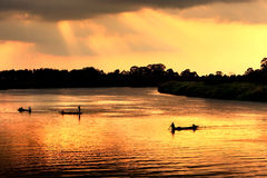 Local fishing boat in dusk with twilight at Chao Phraya River, T Stock Photo