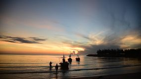 Local fishing boat moving on the sea with sunset. Local fishing boat moving at the sea with sunset stock video footage