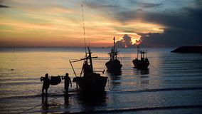 Local fishing boat moving on the sea with sunset. Local fishing boat moving at the sea with sunset stock footage