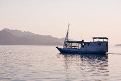 Local fishing boat in the ocean. Local fishing boat. Bali, Indonesia Royalty Free Stock Photography