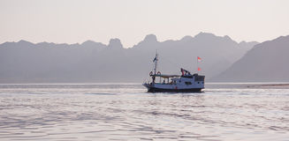 Local fishing boat in the ocean. Local fishing boat. Bali, Indonesia Royalty Free Stock Images
