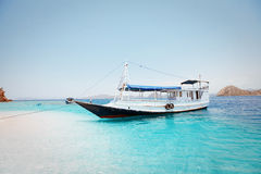 Local fishing boat in the ocean. Local fishing boat. Bali, Indonesia Royalty Free Stock Photo