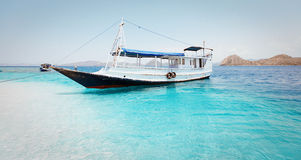 Local fishing boat in the ocean. Local fishing boat. Bali, Indonesia Royalty Free Stock Image