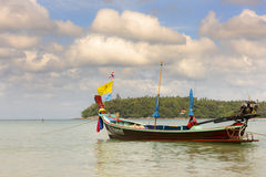 The local fishing boat on the sea and misty cloudy sky backgroun Royalty Free Stock Photos