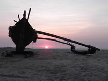 Local fishing boat, at sunset. south goa, india. Stock Photos